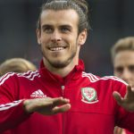 CARDIFF, WALES - JULY 08: Wales' Gareth Bale performs for the crowd during a ceremony at the Cardiff City Stadium on July 8, 2016 in Cardiff, Wales. The players toured the streets of Cardiff in an open top bus before arriving at the Cardiff City Stadium for an after party for which 33,000 tickets have been sold. Wales historic run in Euro 2016 saw them reach the semi-finals, before being knocked out 2-0 by Portugal at Stade de Lyon in France. (Photo by Matthew Horwood/Getty Images)